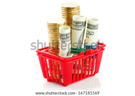 shopping trolley with dollars and coins, isolated on white