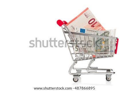 Shopping trolley with Euro banknotes isolated on white
