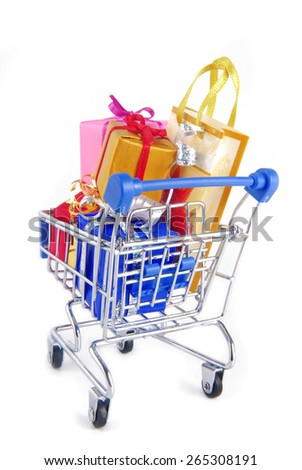 shopping trolley with presents gifts  isoalted on white - stock photo