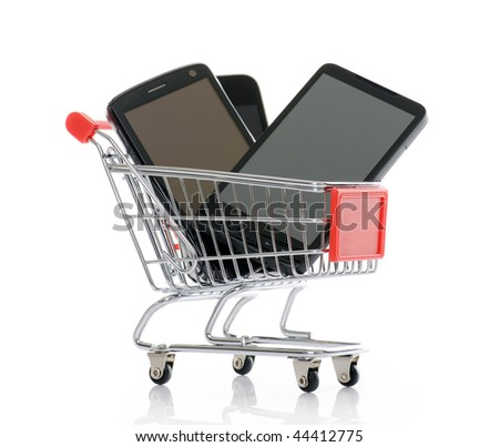 shopping trolley with smart phones - stock photo