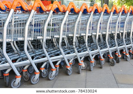 Shopping Trolleys - Supermarket Shopping Theme - stock photo