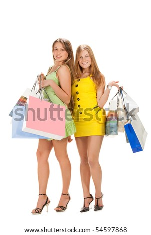 Shopping. Two beautiful girl with bag isolated on white background. - stock photo