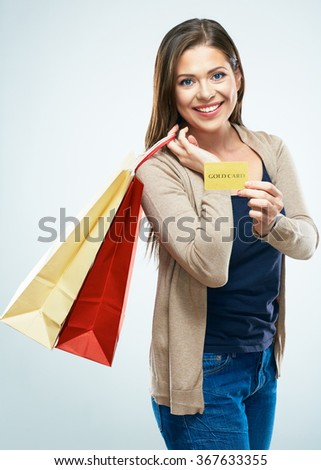 Shopping with credit card. Happy woman hold shopping bag. Studio isolated portrait. - stock photo