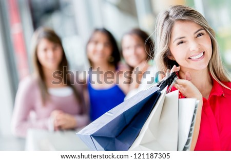 Shopping woman at the mall looking very happy - stock photo