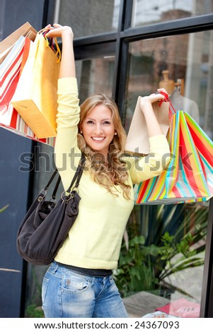 Shopping woman carrying some bags outdoors - stock photo