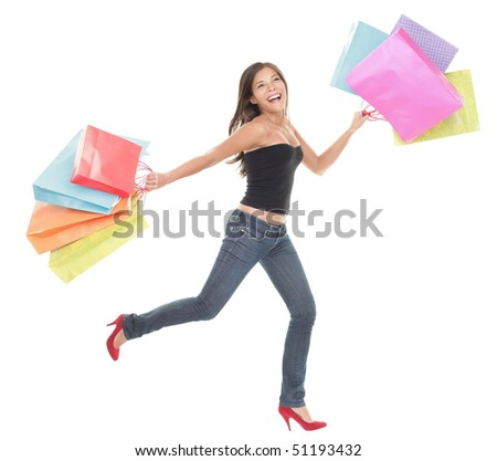 Shopping woman. Cheerful young woman running and jumping of joy holding shopping bags. Full length isolated on white background.