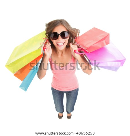 Shopping woman excited and happy. Dynamic and funny image of very hot young woman with shopping bags jumping in full length. Isolated on white background. - stock photo