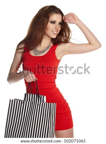 Shopping woman happy smiling holding shopping bags isolated on white background. - stock photo