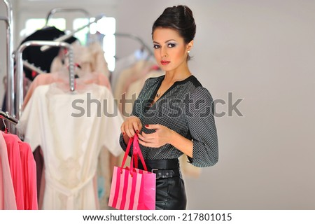 Shopping woman holding bag in retail store - stock photo