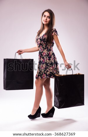 Shopping woman holding bags - stock photo
