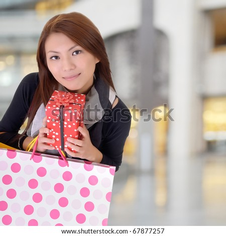 Shopping woman holding bags in modern department store. - stock photo
