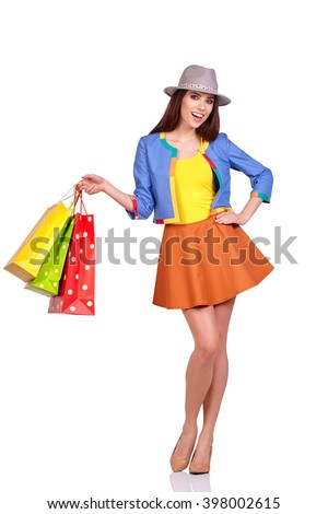 Shopping woman holding bags, isolated on white studio background - stock photo