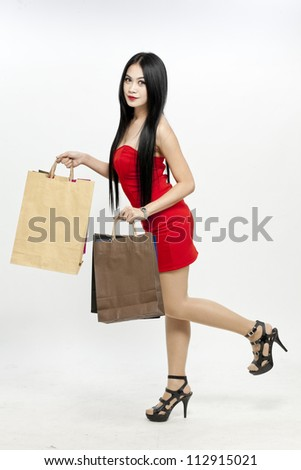 Shopping woman holding shopping bags - stock photo