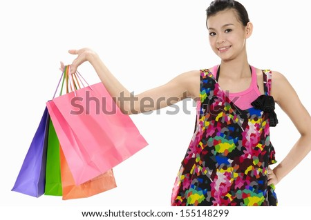 Shopping woman holding shopping bags - stock photo