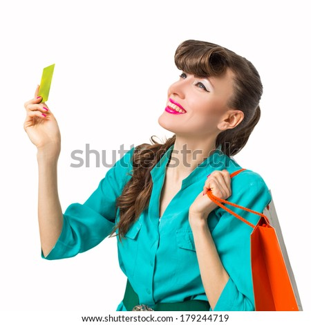 Shopping woman holding shopping bags and credit card . Happy caucasian shopper smiling happy isolated on white background