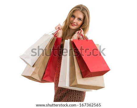Shopping woman holding shopping bags looking at camera on white background at copy space.  - stock photo