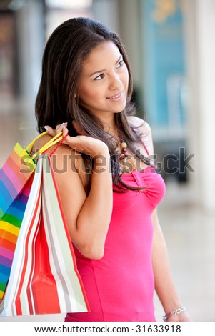 Shopping woman holding some bags at a mall