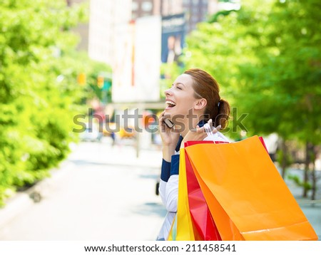Shopping woman in New York City. Beautiful, happy, summer shopper holding shopping bags, smiling talking on phone, yellow taxi cab in background. Positive emotions. Caucasian model in Manhattan, USA. - stock photo