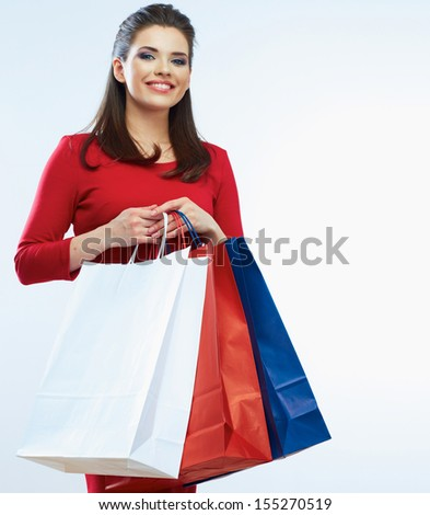 Shopping woman portrait isolated. White background. Happy shopping girl. Red dress. female beautiful model.
