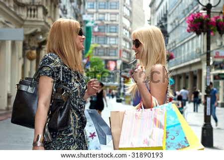 Shopping woman's with bag converse in street environment. - stock photo