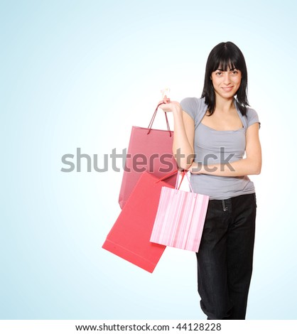Shopping woman smiling. Isolated over blue background - stock photo