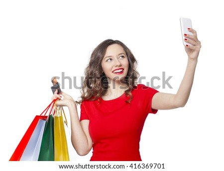 Shopping woman taking a selfie on isolated white background