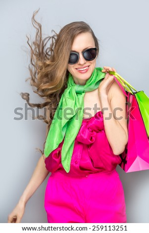 Shopping woman walking with shopping bags in motion happy smiling - stock photo