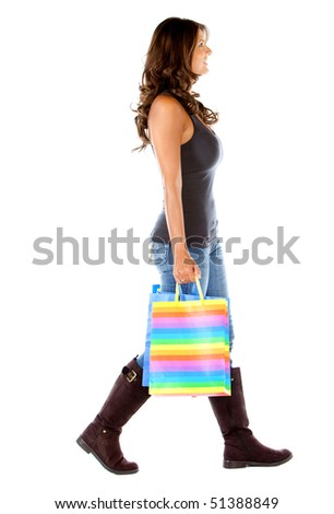 Shopping woman walking with shopping bags - isolated over white