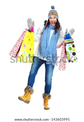 Shopping woman with a bags isolated on white background. - stock photo