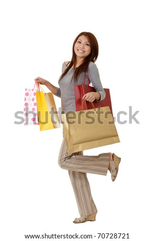 Shopping woman with bags on hand with glade expression on face. - stock photo