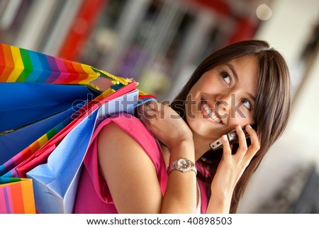 Shopping woman with bags talking on the phone - stock photo