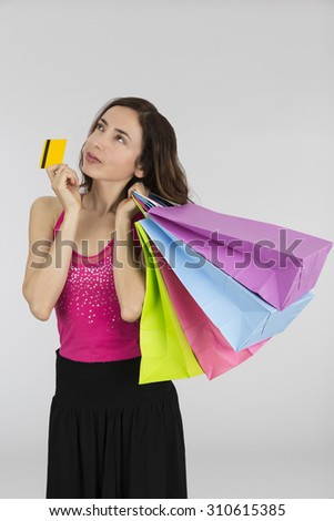 Shopping woman with credit card - stock photo