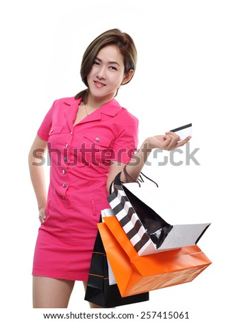 Shopping women asian happy smiling holding shopping bags by credit card isolated on white background. Lovely fresh young Asian female model. - stock photo