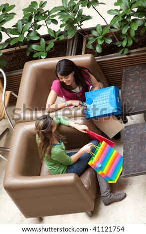 shopping women with bags at a shopping center - stock photo