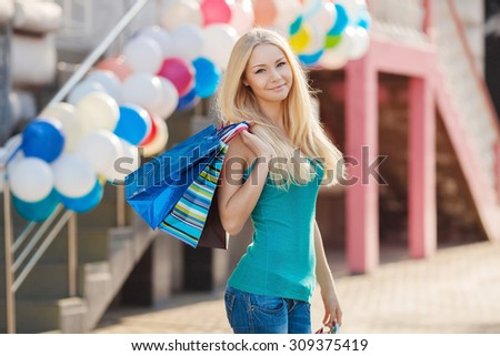 Shopping Women with Digital Tablet on street. Two Young Women with Shopping Bags. Happy friends shopping. Two beautiful young women enjoying shopping at shopping mall - stock photo