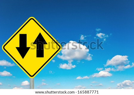 Shopping yellow road sign with clouds and sky in background - stock photo