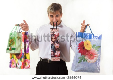 Shopping young man - stock photo