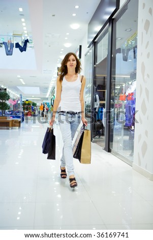 Shopping young woman in shopping mall