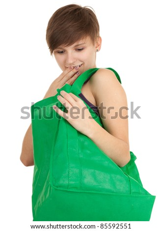 shopping young woman with green ecological bag, white background, series
