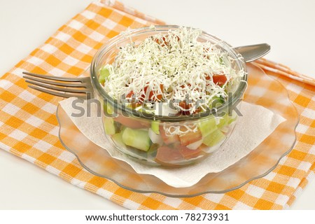 Shopska mixed salad in glass plate and napkin on white - stock photo