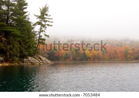 Shore of Killarney Lake in overcast day - stock photo