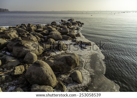 Shore of Lake Mendota with rocks and ice - stock photo