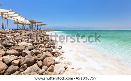 Shore of the dead sea , the salt content in water about 30 percent. - stock photo