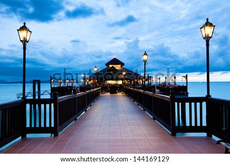Shore restaurant in the dusk - stock photo