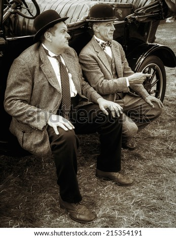 SHOREHAM-BY-SEA, WEST SUSSEX/UK - AUGUST 30 : Laurel and Hardy lookalikes at Shoreham Airshow in West Sussex on August 30, 2014. Unidentified men.