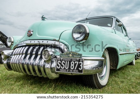 SHOREHAM-BY-SEA, WEST SUSSEX/UK - AUGUST 30 : Old Buick Eight parked on Shoreham Airfield in West Sussex on August 30, 2014 - stock photo