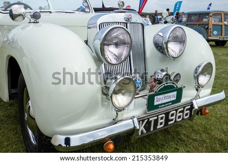SHOREHAM-BY-SEA, WEST SUSSEX/UK - AUGUST 30 : Triumph Roadster on display at Shoreham-by-Sea airfield in West Sussex on August 30, 2014. unidentified people. - stock photo