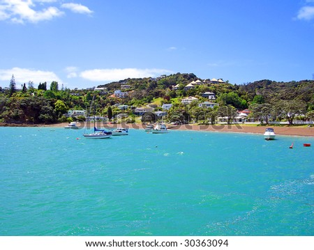 Shoreline of Russell with ocean view houses, New Zealand - stock photo
