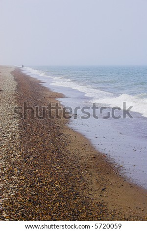 Shoreline of the arctic ocean with sand and water