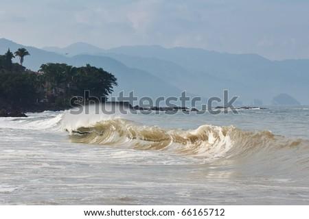 Shores of Banderas Bay near Puerto Vallarta, Mexico. Los Arcos is in the background - stock photo
